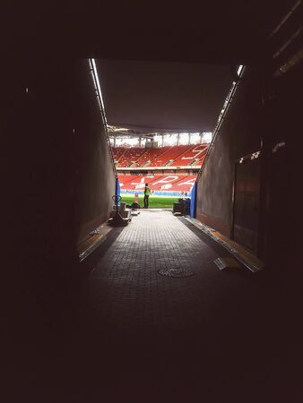 MOSCOW, RUSSIA - JUNE, 13, 2018: Otkritie Arena, Spartak football club stadium included in the Russias bid for the 2018 FIFA World Cup. Arena tunnel with soccer tribune of fans.  View from the player entrance on empty stadium with playing field Editorial