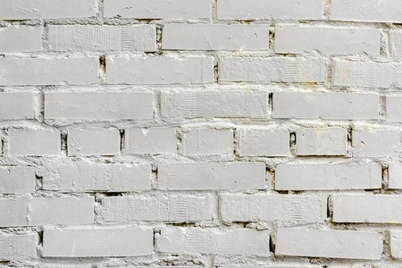 Painted white brick surface, urban background. Graphic grunge texture. For abstract backdrop, pattern, banner design