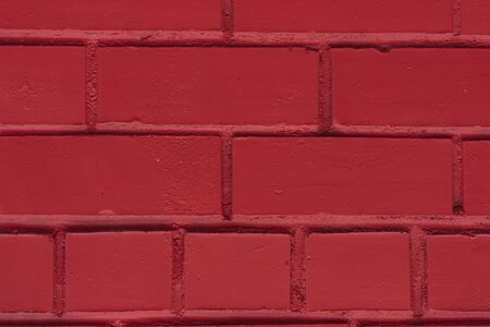 Painted red color brick wall surface. Modern background.