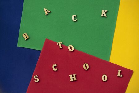 Back to school text, wooden letters. Concept of education, starting school, back to school. Colorful background Imagens - 129626144