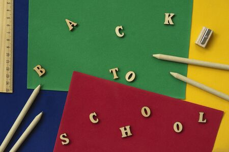 School wooden supplies and Back to school text. Concept of education, starting school, back to school Imagens - 129626157