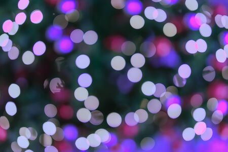 Abstract colorful violet purple bokeh design, defocused lights, holiday background. Festive occasions concept, Christmas, New Year backdrop