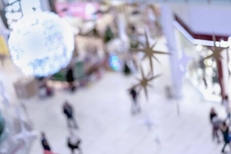 Abstract blurred background of Christmas decorated shopping mall Imagens