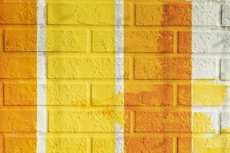 Bricks surface of wall, painted striped in bright orange and yellow colors. Graphic texture of colorful wall, for background Imagens - 129626212