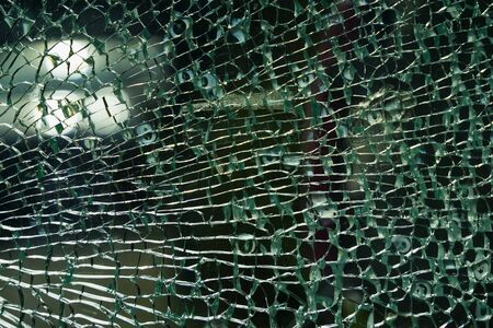 Texture of broken green glass with little cracks , abstract background