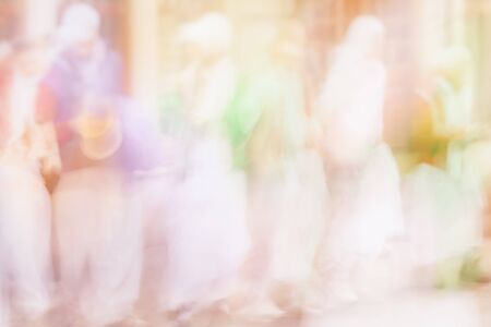 Abstract blurred people group of Hare Krishna, light colorful background Imagens