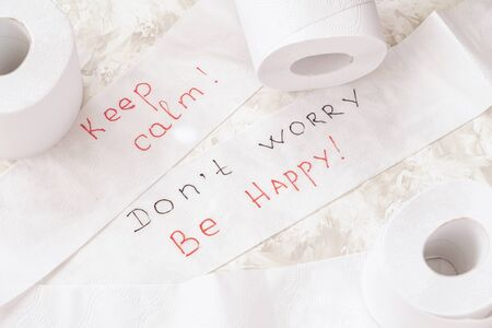 White toilet paper on light background, three rolls, top view, supporting slogan, text