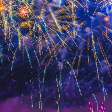 Picturesque sky in colorful sparks of festive fireworks, colored smoke and bright nebula, holiday background Imagens