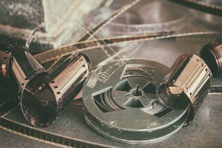 Aged dirty movie rolls, retro reels, filmstrip, photographic film. Vintage dark background, retro style. Photo, movie, cinema concept