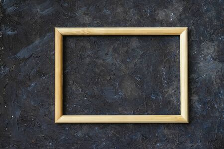 Classic wooden frame mockup on dark dirty wall, for background Imagens