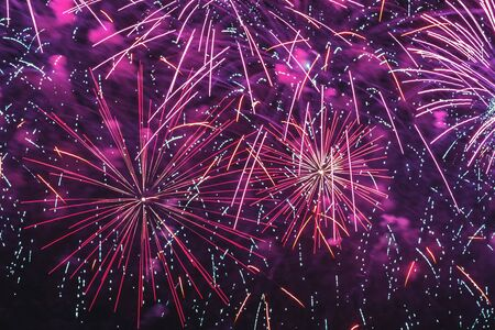 Bright fireworks with sparks. Explosive pyrotechnic devices for aesthetic and entertainment purposes, art. Holiday backdrop for all festive occasions
