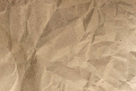 Wrinkled paper. Recyclable material, texture, vintage cardboard, background