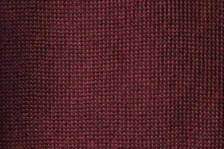 Abstract burgundy texture of jute, canvas, sackcloth, modern fashion background