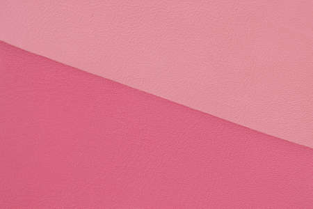 Texture of genuine leather, two variety shades of pink colors. Fashionable modern background, copy space