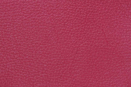 Texture of genuine leather close-up, fashion shade of burgundy red color, matte surface, trendy background, copy space Standard-Bild