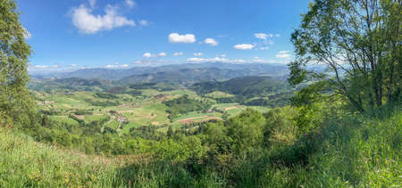 Panorama of countryside, wonderful summer landscape, mountain meadows, rural scenery. Mountain valley village landscape