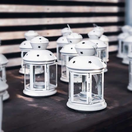 Romantic white metal lanterns with a candles