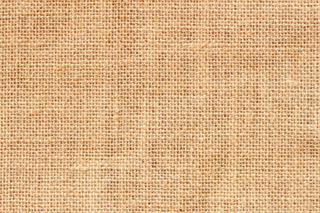 Natural organic sackcloth background, texture closeup of burlap, canvas, pattern for vintage backdrop