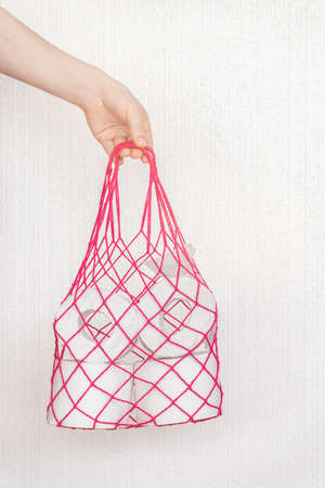 Girl's hand holds a bag. Zero waste grocery shopping concept and Concept of problem with consumer essential goods, virus, hygiene, health and antipanic Standard-Bild