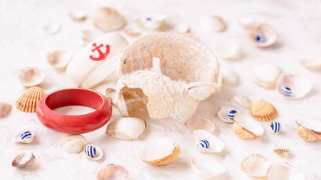 Set of seashells and plastic bracelets in a nautical style, summer jewelry, top view, summer vacation concept