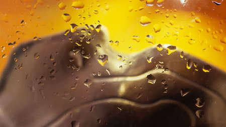 Abstract scenic background with raindrops on glass, city illuminated neon lights. Bright colors of yellow and brown colors. Modern design.
