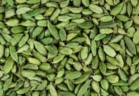 Trockener grüner Kardamomhintergrund Standard-Bild - 73633071
