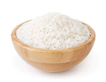 White long-grain rice in wooden bowl isolated on white background