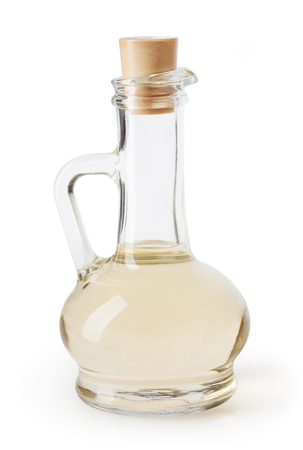 White vinegar in glass bottle isolated on white background