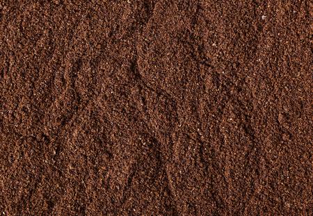 Gemalen gebrande koffieboon achtergrond Stockfoto
