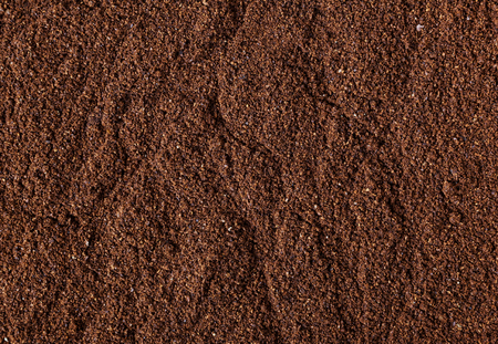 Ground roasted coffee bean background Banco de Imagens
