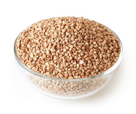 Roasted buckwheat grains in glass bowl isolated on white background with clipping path