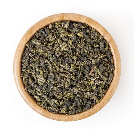 Milk oolong green tea in wooden bowl isolated on white background with clipping path