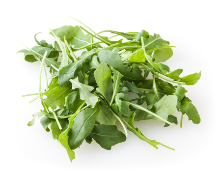 Heap of fresh arugula leaves isolated on white background