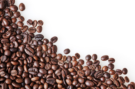 Roasted coffee beans on white background with copy space