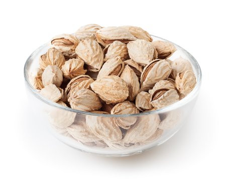 Almond nuts in glass bowl isolated on white background