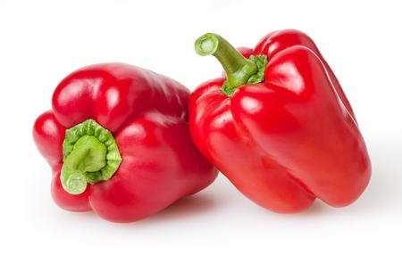 Fresh red bell peppers isolated on white background 写真素材