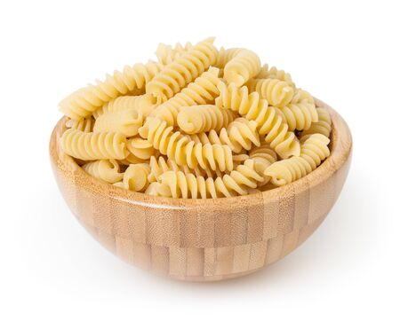 Uncooked fusilli pasta in wooden bowl isolated on white background Zdjęcie Seryjne