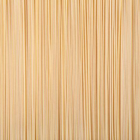 Uncooked dried spaghetti pasta background