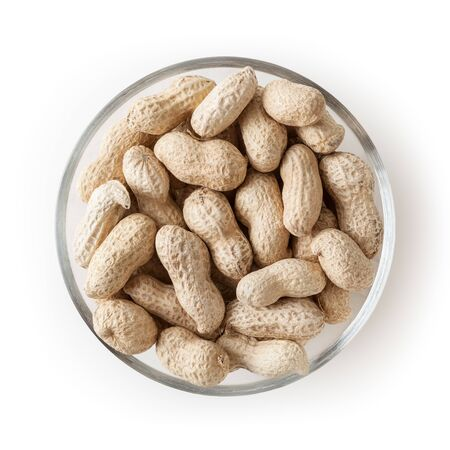 Raw peanuts in glass bowl isolated on white background