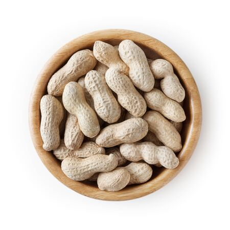 Raw peanuts in wooden bowl isolated on white background