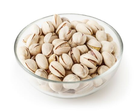 Salted pistachios in glass bowl isolated on white background