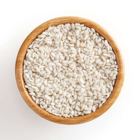 Uncooked arborio rice in wooden bowl isolated on white background with clipping path Stockfoto