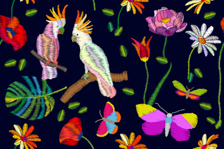 A Seamless vector pattern with cockatoos, palm leaves and flowers. Embroidered texture. Vintage textile collection.