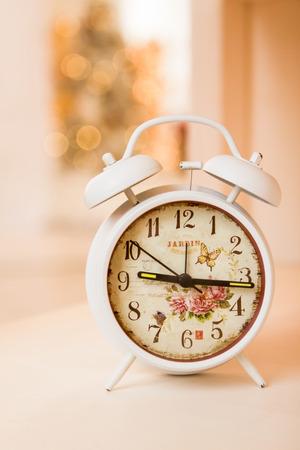 Retro alarm clock with five minutes to twelve o'clock. Old style filtered photo. Retro alarm clock Stockfoto