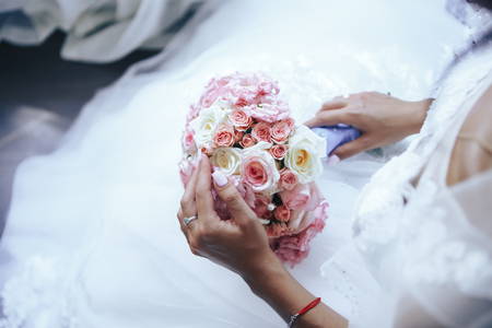 The bride holds a wedding bouquet. Close-up.