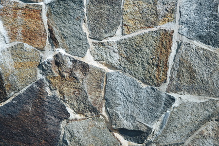 Old gray stone wall background. Background of stone wall texture.