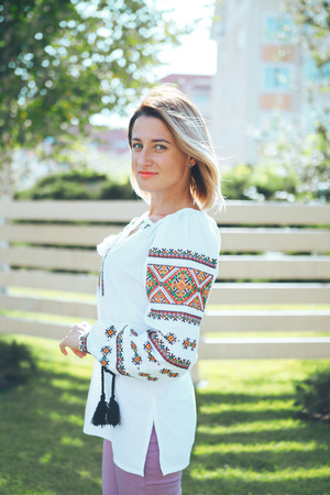 Beautiful young woman in traditional ethnic ukrainian  style. Vyshivanka blue with white embroidery