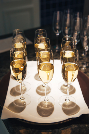 Glasses with champagne on a tray.
