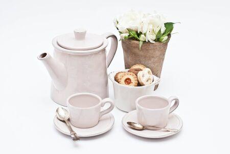teacups: Teapot, teacups and cookies
