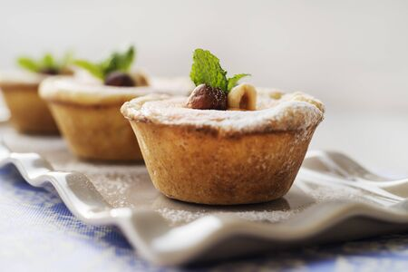 tarts: Cream cheese tarts with mint and nuts